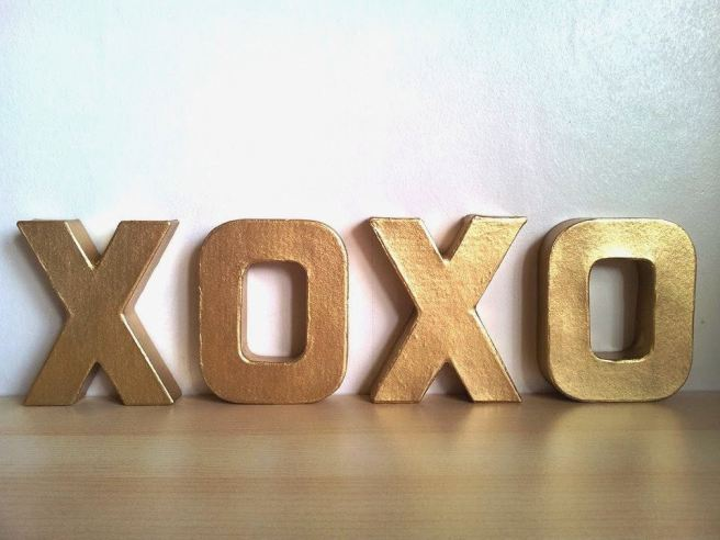 Gold letters spelling XOXO