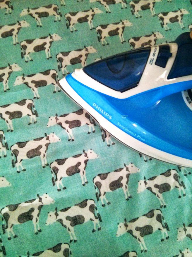 ironing fabric with cows on
