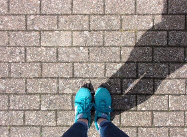 feet-on-brick-path